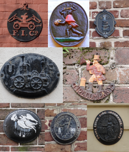 Fire markers on various Charleston buildings.
