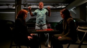 Mr._Burt_dances_as_Dana_Scully_and_Monica_Reyes_play_checkers